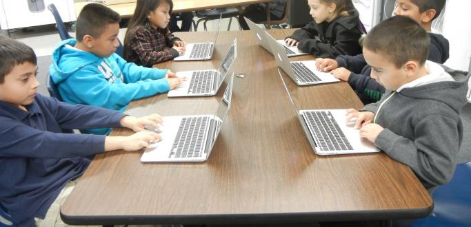2nd graders enjoying Tech Time!